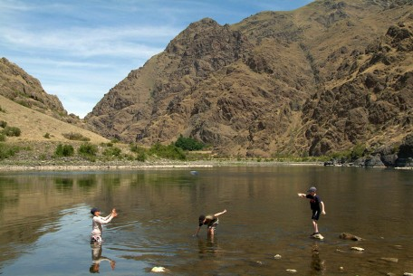 A riverside game of catch football is both fun and refreshing