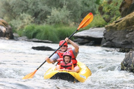 Paddling an Inflatable Kayak through the Class II Rapids