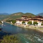 "The Mo Chhu flowing past the Punakha Dzong, or ""palace of great happiness."""