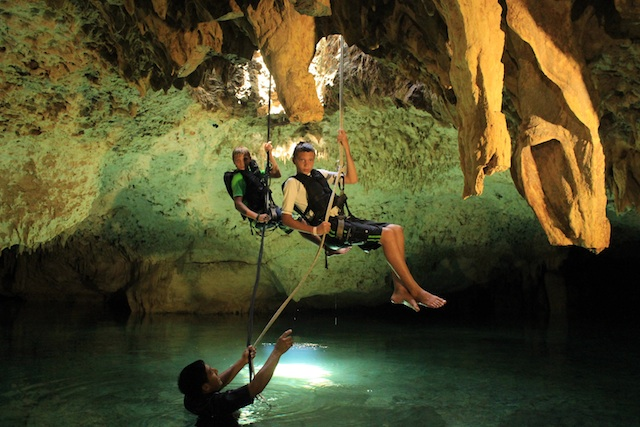 rappeling in a cenote