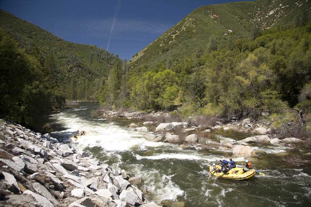 Whitewater rafting on the Merced River which flows out of Yosemite national Park, CA.
