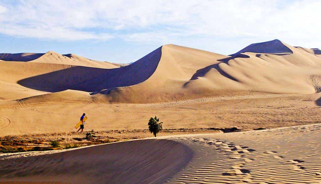 10 Must-Do Peru Adventures That Aren't Machu Picchu | Sandboard massive sand dunes in Huacachina | Photo: Justin Vidamo / WikiCommons