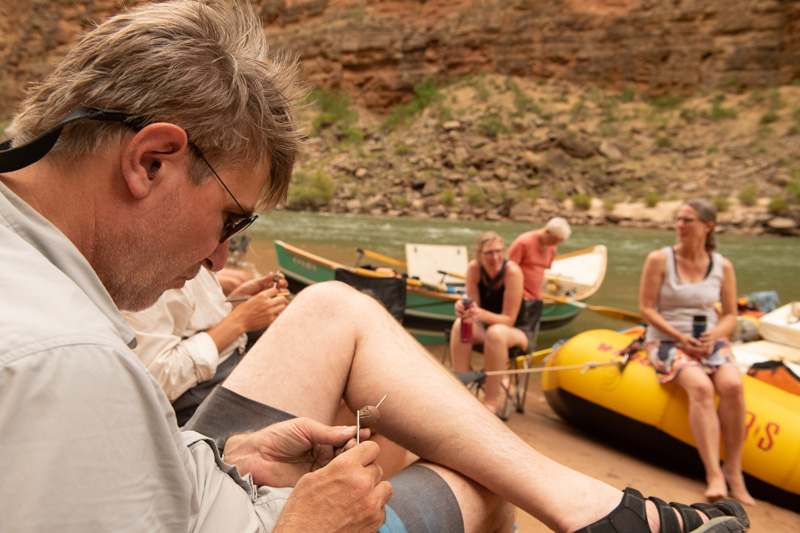 Making clay beads on a Grand Canyon rafting trip