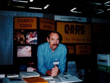 George Wendt working a trade show booth in the early days of OARS