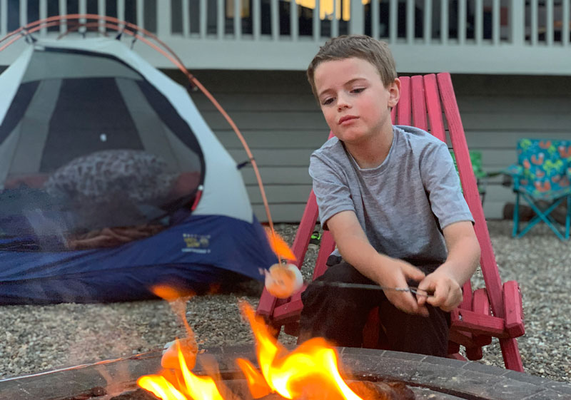 boy roasting marshmallow over fire
